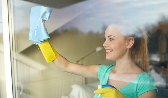 window cleaning woman in gloves